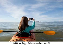 Woman floating water kezar lake maine usa Stock Photos and Images.