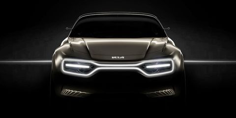 Kia Teases EV Concept with New Logo and Grille Made of Lights.