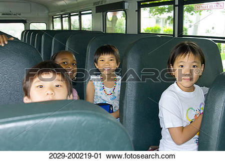 Stock Photography of Young children on school bus. 2029.