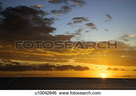 Stock Images of Sunset sky over the Pacific Ocean in Kihei, Maui.