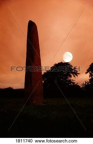 Stock Photography of Standing stone with moon, Punchestown, Co.
