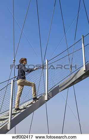 Picture of Germany, Stuttgart, Teenage boy climbing stairs of.