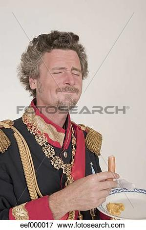Picture of Man as King Ludwig of Bavaria eating bockwurst.