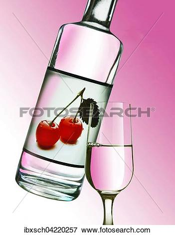 Picture of Kirsch, cherry liquor in a bottle, with a glass poured.