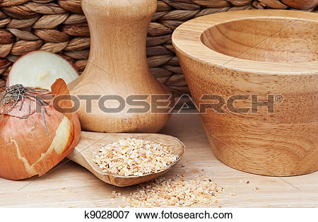 Picture of Minced Garlic and onion in rustic kitchen setting.
