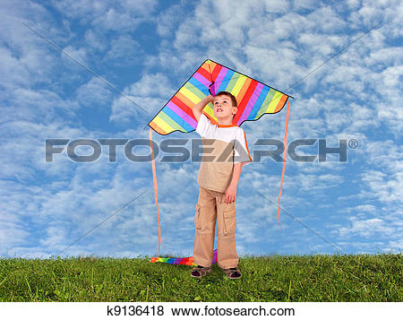 Pictures of boy child with kite on meadow collage k9136418.