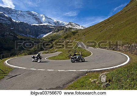 """Stock Photography of """"Motorcyclists in a hairpin curve, mountain."""