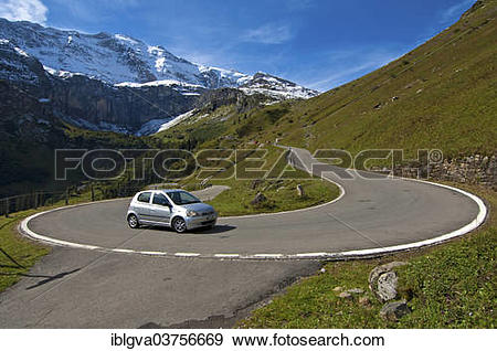 """Stock Photograph of """"Car in a hairpin curve, mountain road to the."""