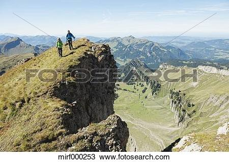 Stock Photo of Austria, Kleinwalsertal, Man and woman hiking on.