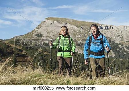 Stock Image of Austria, Kleinwalsertal, Man and woman hiking on.