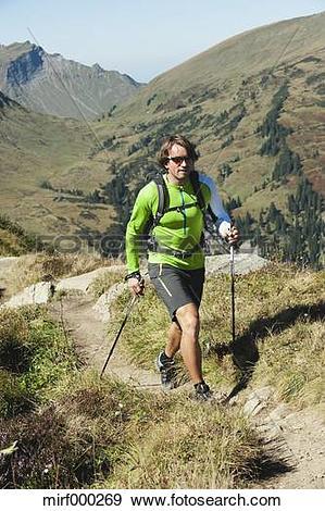 Stock Photograph of Austria, Kleinwalsertal, Mid adult man hiking.