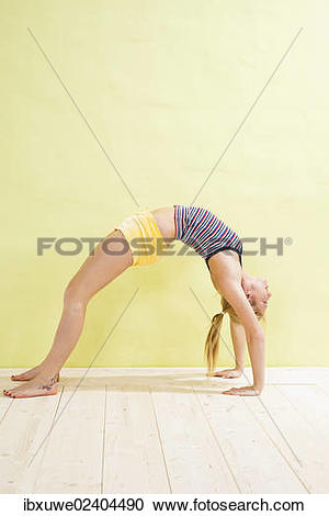 Stock Photography of Young woman doing a bridge ibxuwe02404490.