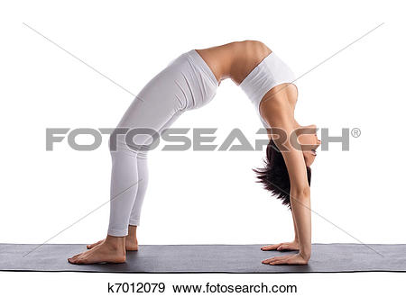Stock Photograph of young woman in yoga asana.