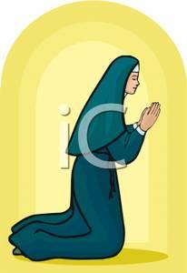 Nun Kneeling In Prayer.