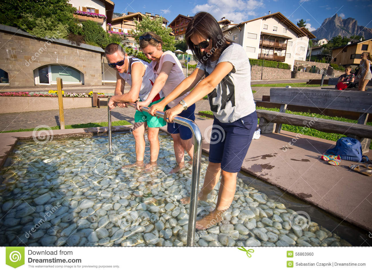 Tourists In Kneipp Pool In Castelrotto, Italy Stock Photo.