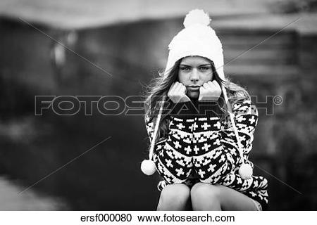 Stock Photography of Portrait of angry young woman wearing bobble.
