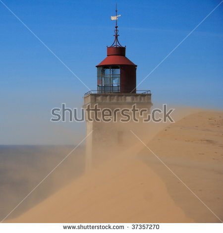 Lighthouse In The Sand Dunes Of Rubjerg Knude In Denmark Stock.