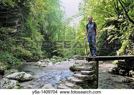 Stock Photo of Male hiker at Kozjak brook, Kobarid, Slovenia.