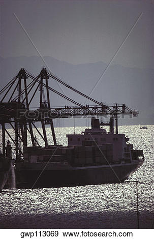 Stock Photograph of Silhouette of a industrial ship in the sea.