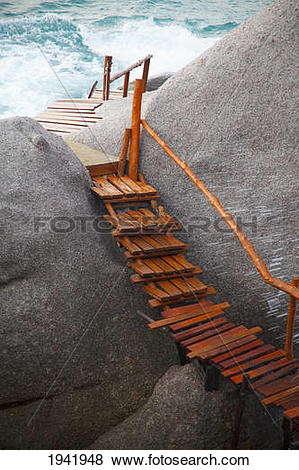 Pictures of Wooden Boardwalk On The Rocks Along The Ocean; Koh Tao.