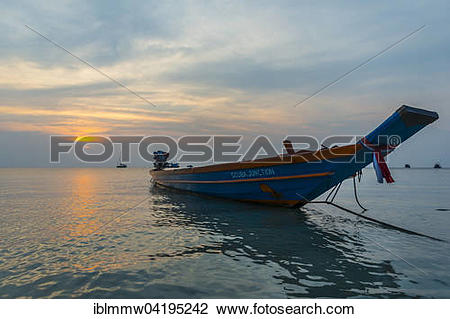 Stock Photo of Longtail boat in the sea at sunset, Koh Tao, Gulf.