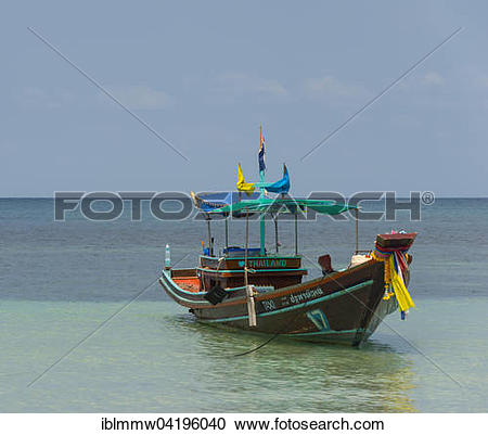 Stock Photography of Longtail boat in the turquoise sea, island of.