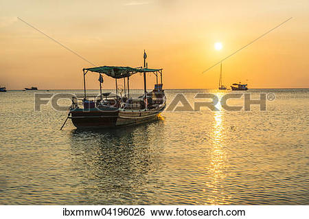 Stock Images of Fishing boat in the sea at sunset, Koh Tao island.