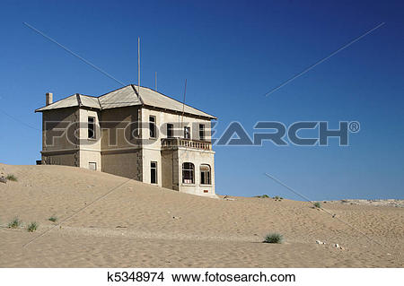 Stock Photo of Old ruin in the abandoned diamond town Kolmanskop.