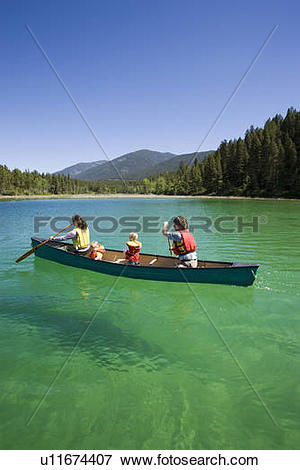 Picture of Young family canoeing on Loon Lake in the East.