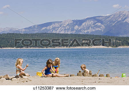 Picture of Children playing on beach on Lake Koocanusa in the East.
