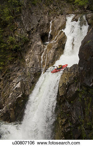 Stock Images of a kayaker running down Needles, Whatshan River.