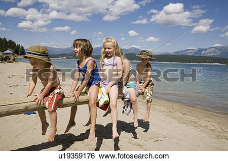 Stock Images of Children playing on beach on Lake Koocanusa in the.