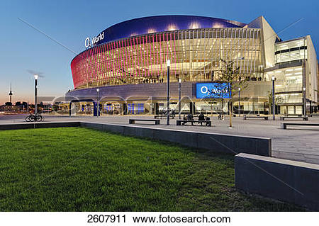 Stock Photography of Office building lit up at dusk, O2 world.