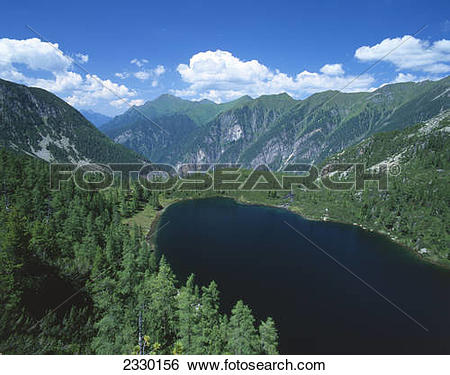 Stock Images of High angle view of lake surrounded by mountains.