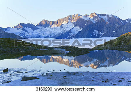 Stock Photography of Mountain lake reflecting Zillertal Alps.