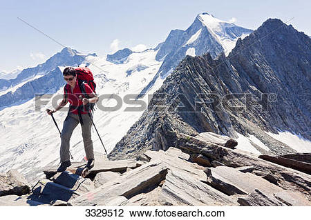 Stock Photo of Woman hiking at Schoenbichler Horn, Zilltertaler.