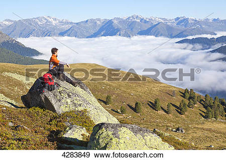 Stock Photograph of Woman hiking, Nauderer Tschey, Oetztal Alps.