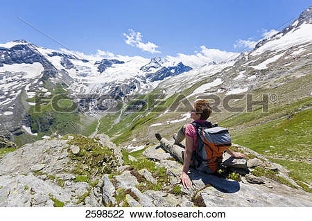 Stock Photo of Hiker looking at mountains view, Hohe Tauern, Alps.