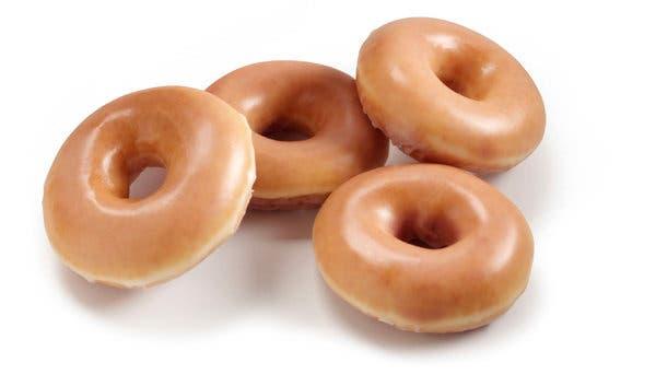Krispy Kreme\'s New Owner Dunks Doughnuts in Coffee Empire.