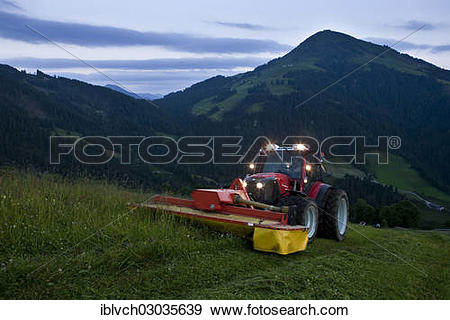 "Stock Photograph of ""Tractor mowing hay, Soll, Kufstein District."