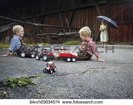 "Stock Photo of ""Children playing with toy tractors on farm, Reith."