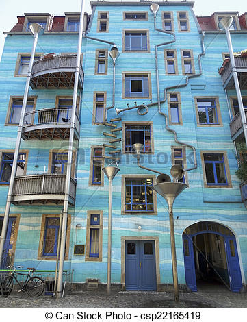 Stock Photography of blue house facade including lots of art.