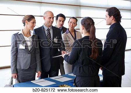 Stock Photo of Supplying documentation to conventioneers.