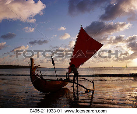 Stock Photography of Indonesia, Bali, Kuta Beach, Outrigger Boat.
