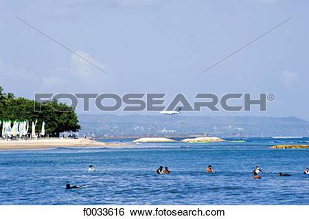 Stock Images of Indonesia, Bali, beach of Kuta, plane landing.
