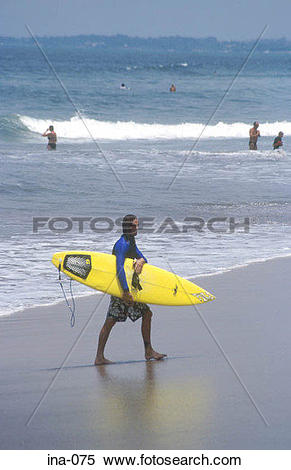 Stock Image of Surfer Carrying Surfboard Kuta Beach Bali ina.