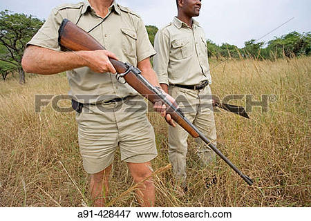 Picture of Park Rangers Ryan Kewley and Thomas Nsele. Game drive.