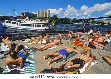 Stock Photo of Sunbathers on cement pontoon at Langholmen Island.