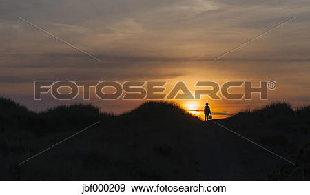 Stock Photograph of Denmark, Jutland, Lokken, girl in dune at.