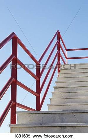 Stock Image of pedestrian overpass with concrete steps and red.